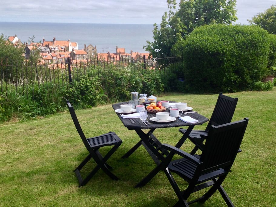 Breakfast on the lawn is an option, with stunning views of the village and sea.