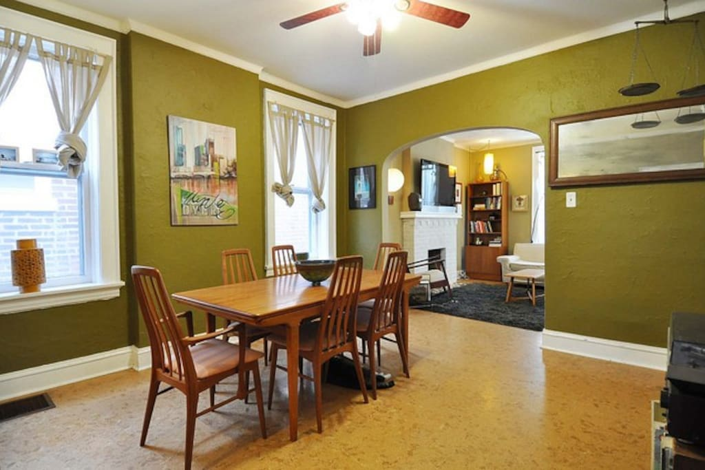 Spacious dining room with original hand-crafted mid-century teak dining set.