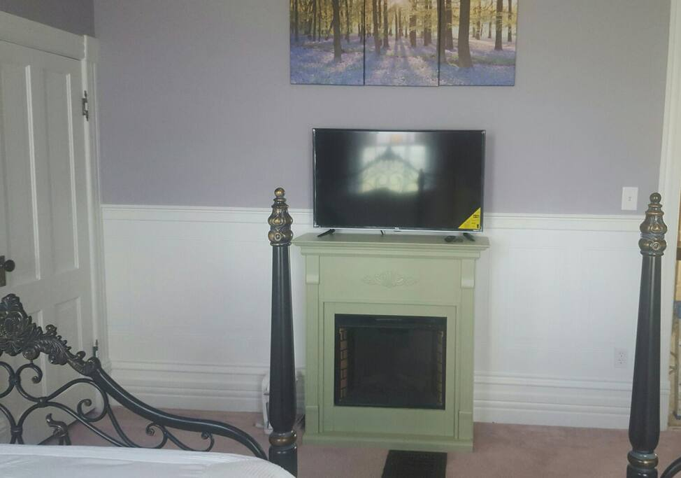 "Large, flat screen ""smart"" TV with internet access.  Animated fireplace heater."