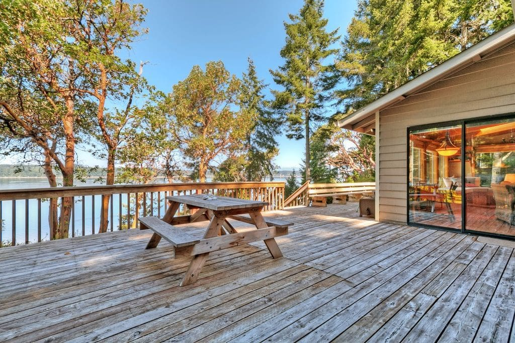 Huge deck with sweeping western views of the Olympic Mountains, Case Inlet, McMicken Island, Harstine Island, Oscar, Eagles and more!