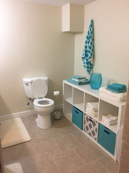 Shared bathroom with towels available