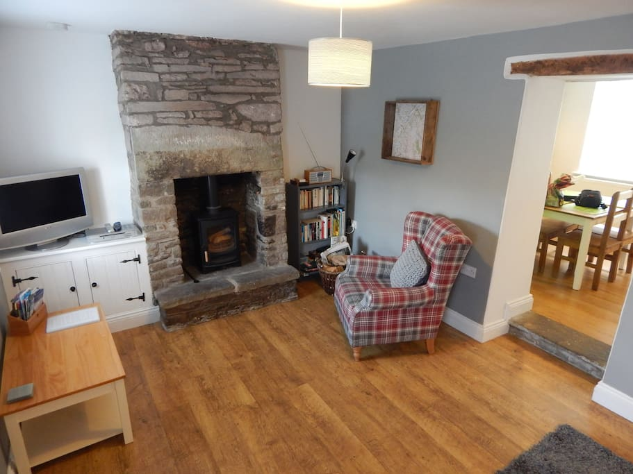 Living room with log burner and comfy armchair