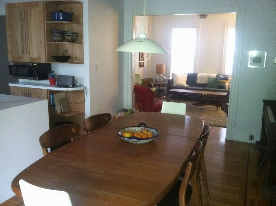 The dining room and living room, with the kitchen to the left.