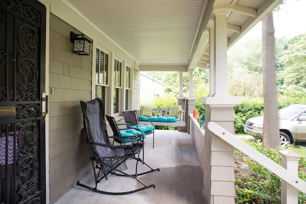 Our beautiful front porch, with many chairs, a rocking chair and swing!
