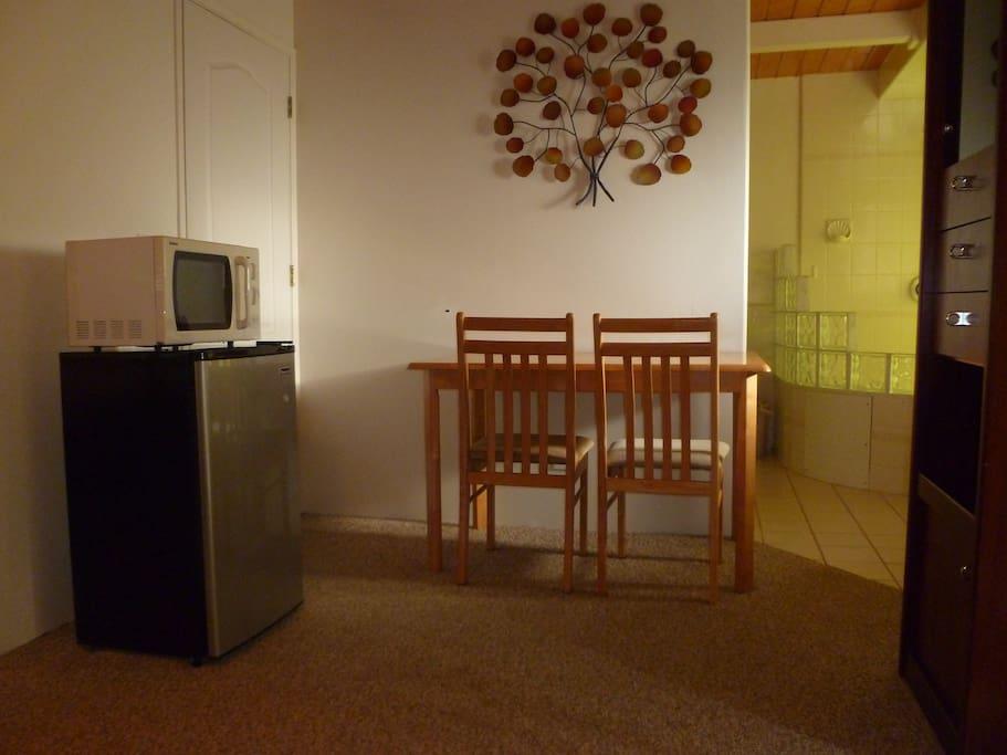 Writing desk, microwave and mini fridge.  Bedroom door is locked off.