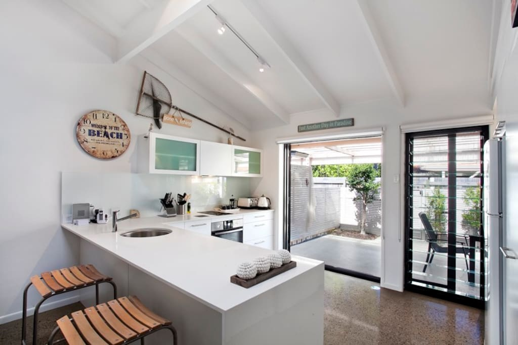 Modern, fully equipped kitchen which leads out to the private courtyard.