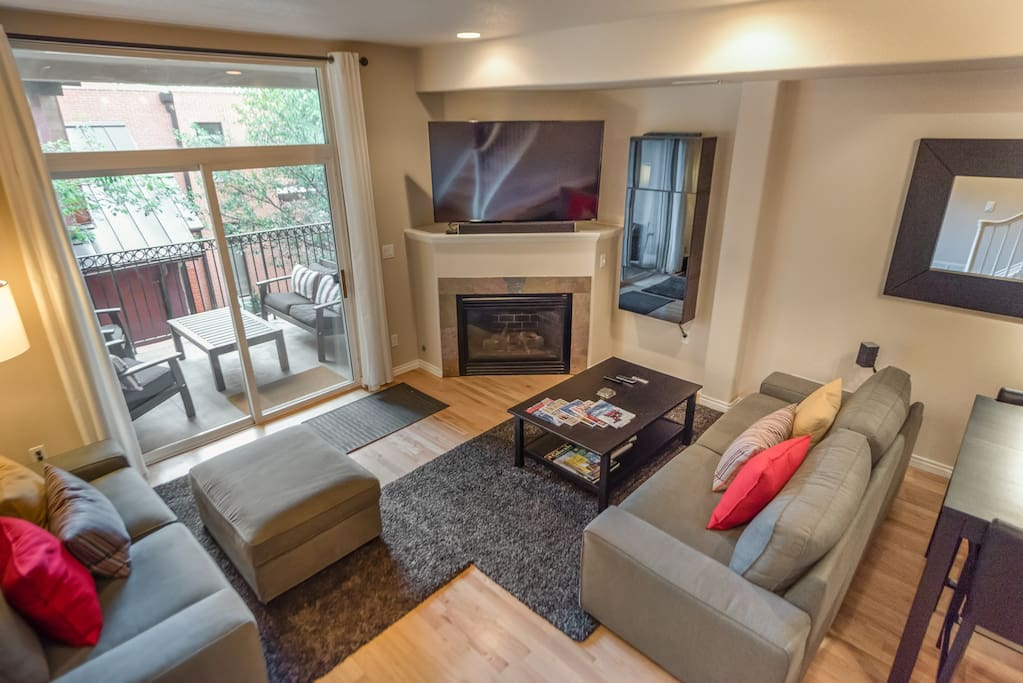 Spacious living room with gas fireplace and large Smart TV!
