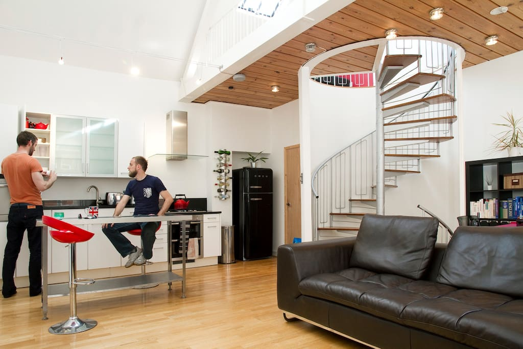 Open plan kitchen and living room, overlooked by the mezzanine