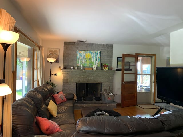 When the shades are open the outside comes in and it's just beautifully bright inside. However we have heavy duty shades and drapes for your convenience and privacy. The door leads out to the glass/ screen enclosed porch with great breezes and views