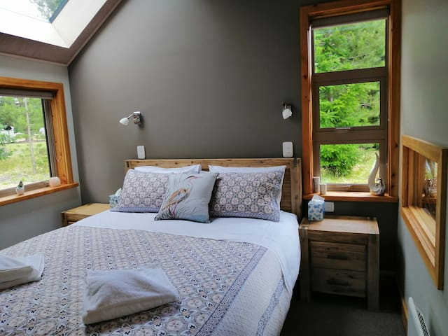 Master bedroom with skylight window and lots of natural light.