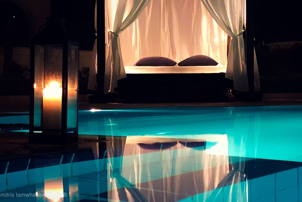 Romantic night bed by the pool