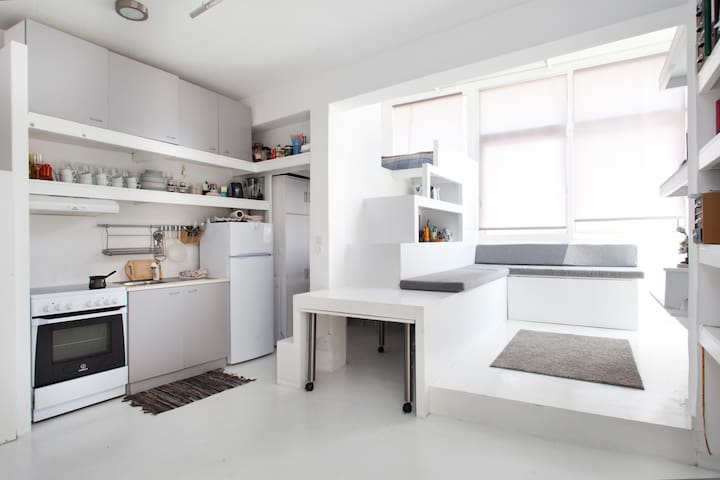 A general view of the apartment -  (The kitchen, The dressing room or guest' s room,The stairs that drives you upstairs at the main bedroom,The flexible dining table The flexible living room)