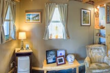 Local art and photography adorns the cabin walls.