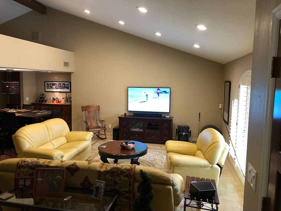 Living room w/ large flat screen & surround sound.  Karoake Machine.