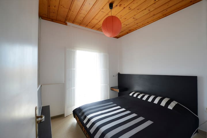 The master bedroom is a minimal space,  equipped with a  king size bed and  a comfortable, anatomic mattress.