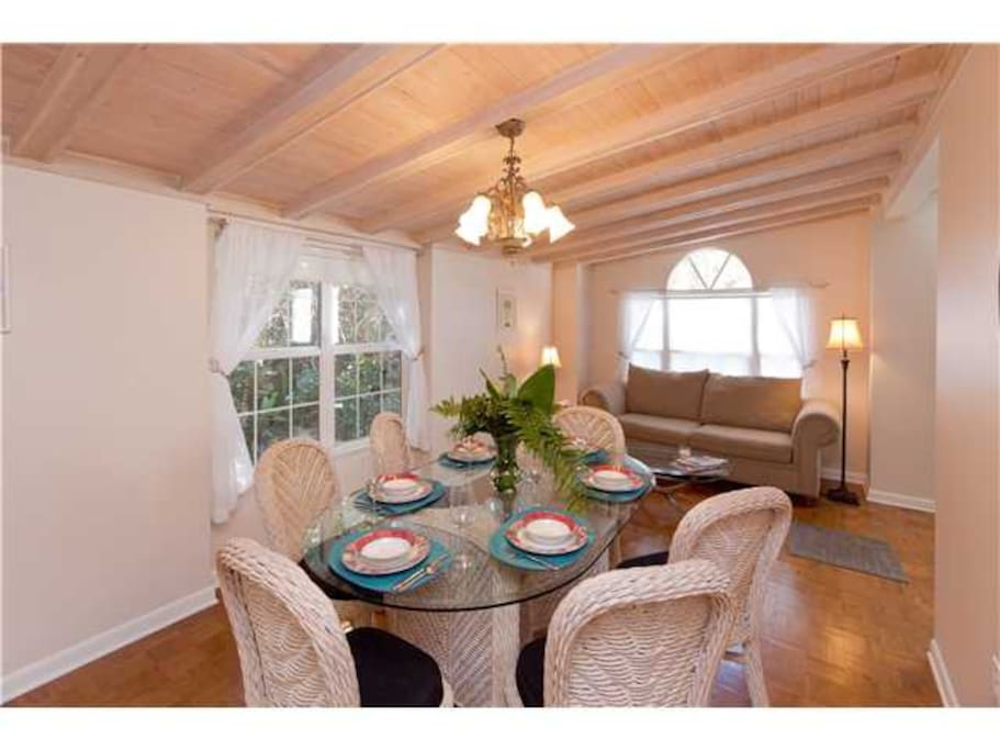 full, spacious dining room with sliding doors into third bedroom with memory foam sleeper sofa