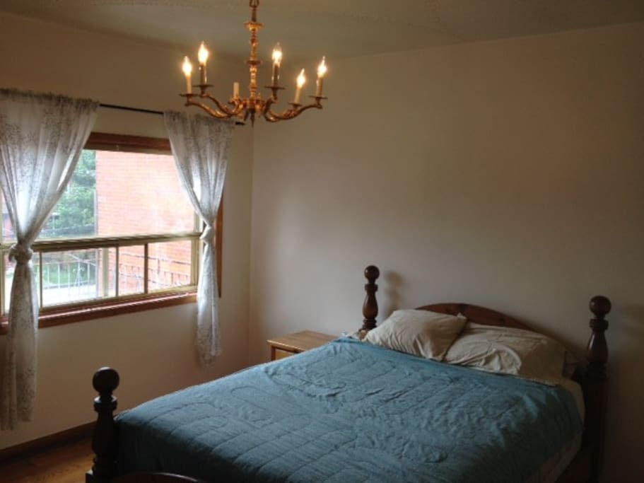 Queen size bed (and gold chandelier for extra class)