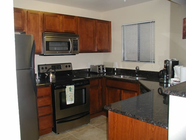 Gourmet kitchen  stainless steel appliances, granite counter tops