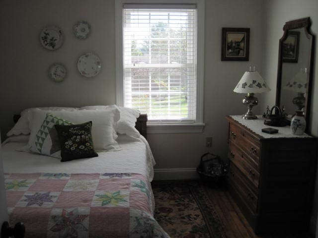 1st floor bedroom with full bed and bath with walk in shower.