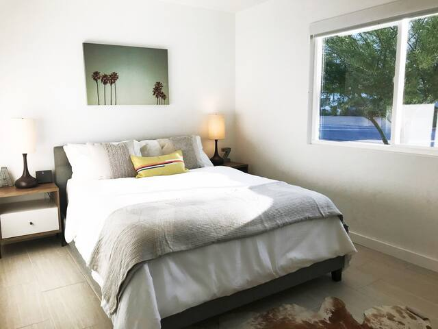 Third bedroom with queen bed and built in closet