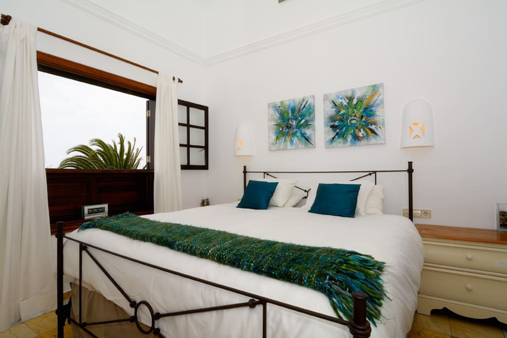 Master bedroom with huge  Eastern king size bed leading to rooftop balcony with stunning volcano and ocean views to Fuerteventura.