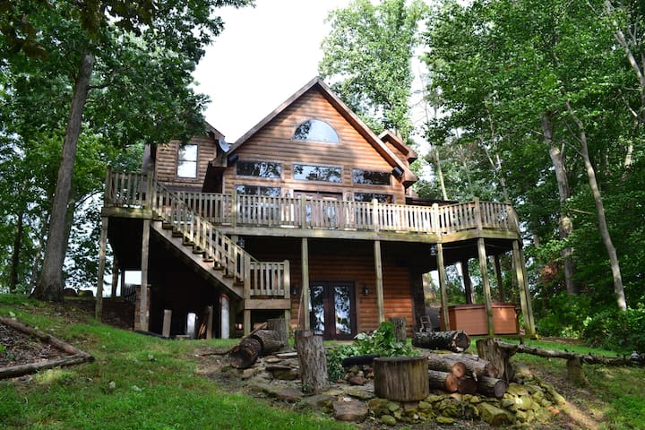 View of the back of the house - The deck overlooks the lake