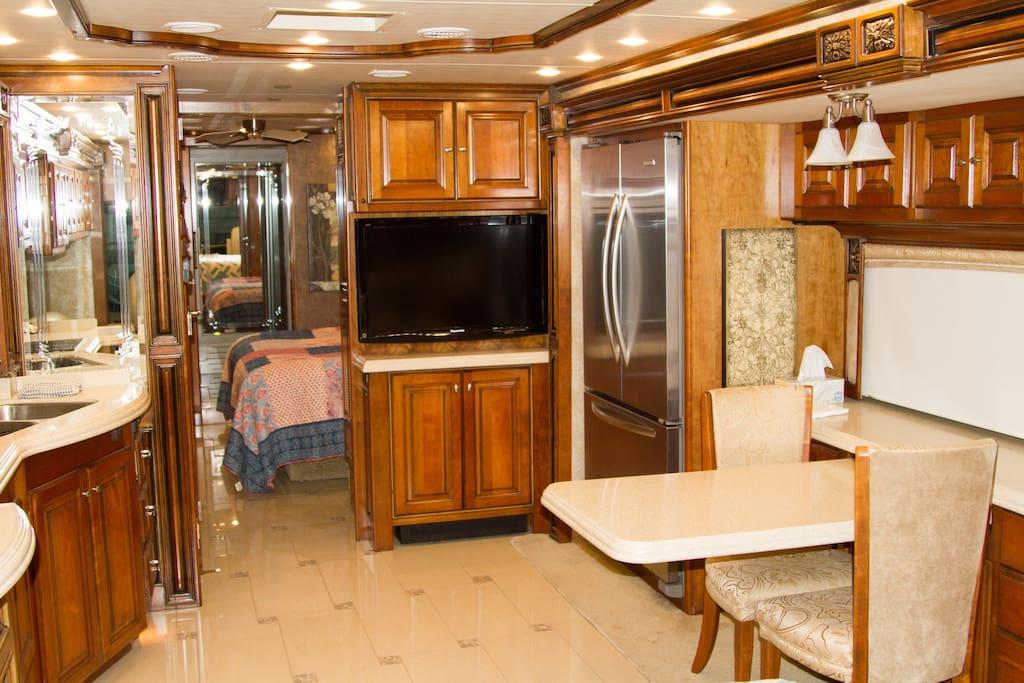 Kitchen/dining area with full fridge