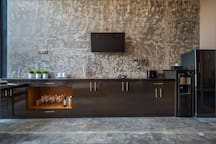 Fully equipped kitchen with modern appliances and bar