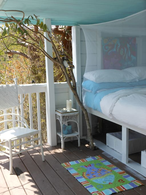 The Life's A Beach Suite includes a super-comfy, open-air queen bed with a view of the Caribbean Sea, banana quits and a tree at your bedside, fan, reading light, great breezes, awesome sunrises you can see without lifting your head from the pillow!