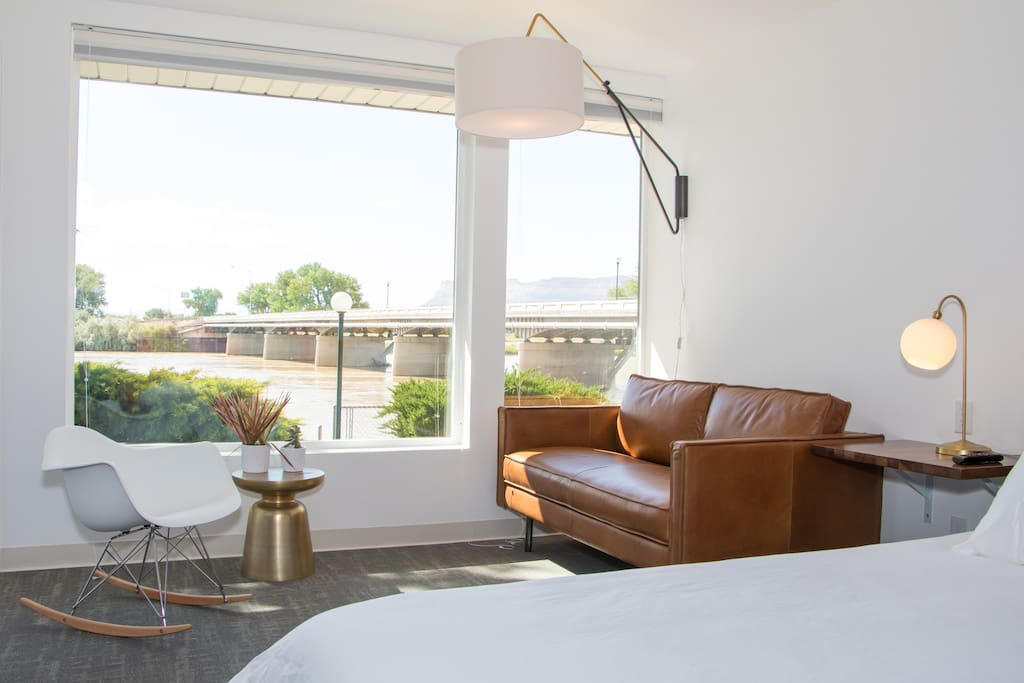 The Crystal Geyser Guestroom with views of the Green River and Book Cliff Mountain Range behind