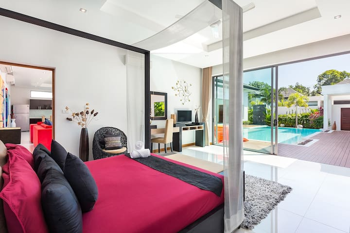 Master bedroom opening on the pool