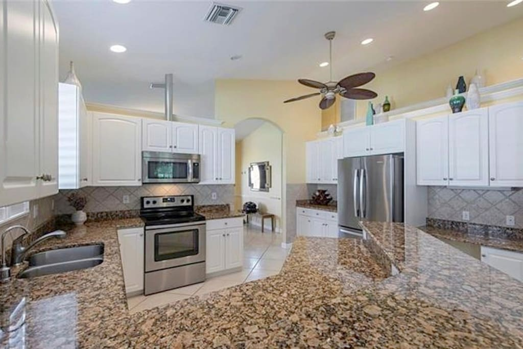 Fully equipped kitchen with large fridge, high ceilings and lots of natural light