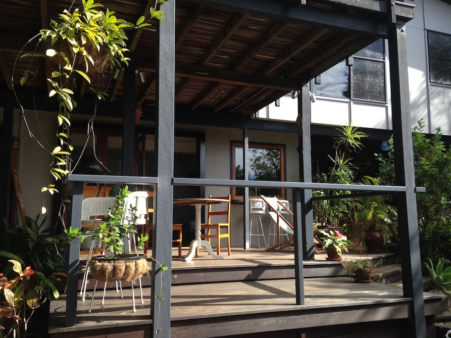 The Cove Studio deck with bifolds  opening on to it. A sunny spot in the morning.