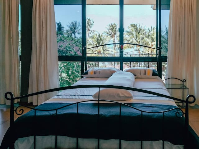 With our wide windows, wake up to a beautiful tropical morning, and a view of the sea without ever leaving your bed.