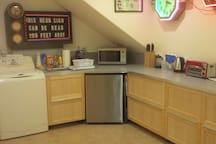 From left to right, washer (not shown) dryer, sink, refrigerator, microwave/convection oven, knives, toaster oven, lots of drawers and counters.