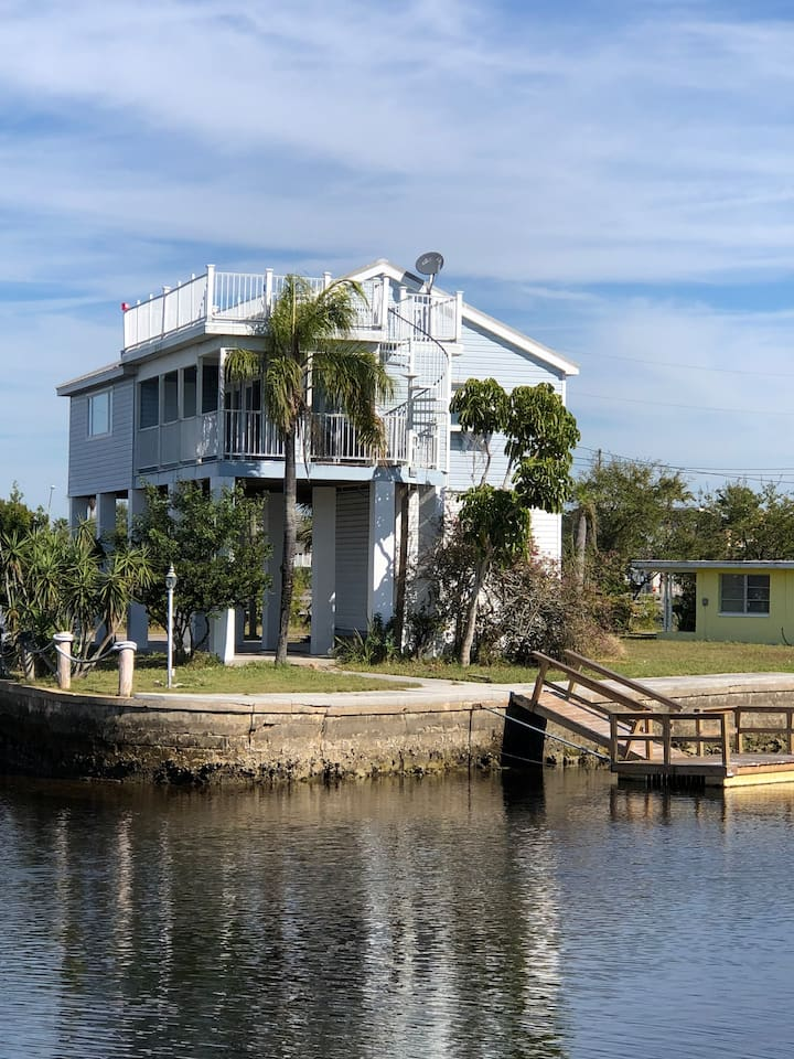 This house is on the end of canal before going into the gulf . Comes with dock .