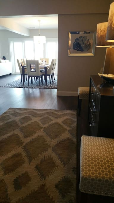 Entrance into condo.   Open concept . Great for entertaining with 180 degree views throughout this unit of ocean and harbor.