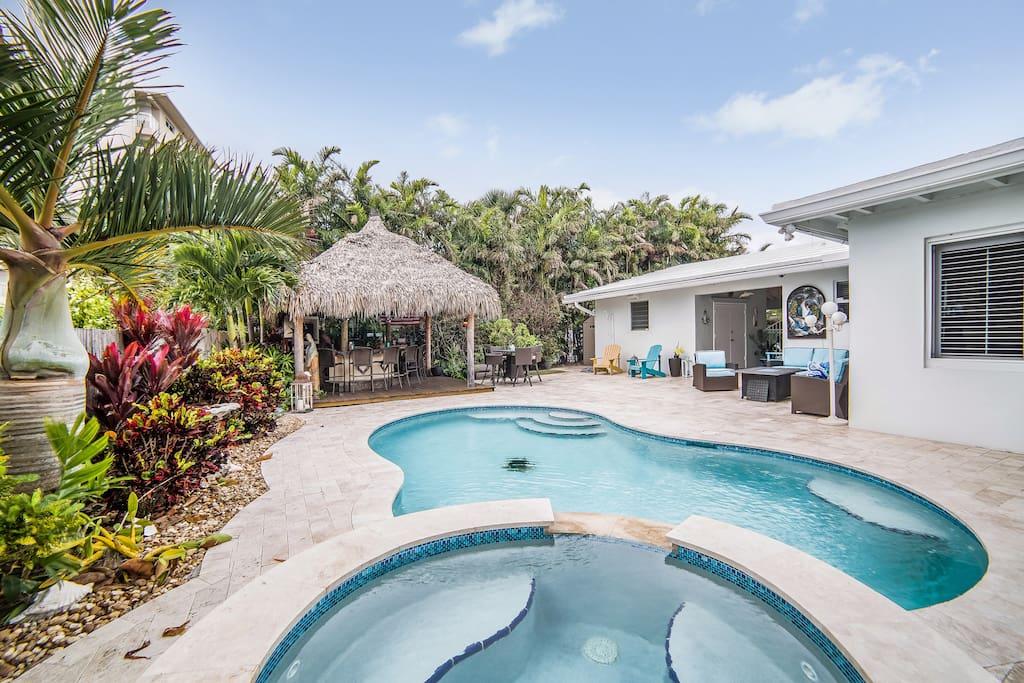 Backyard view of beautiful pool, Tiki Bar and sitting area.