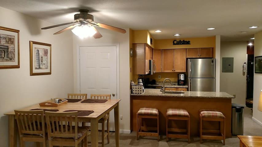 Dining area and large kitchen counter with additional seating