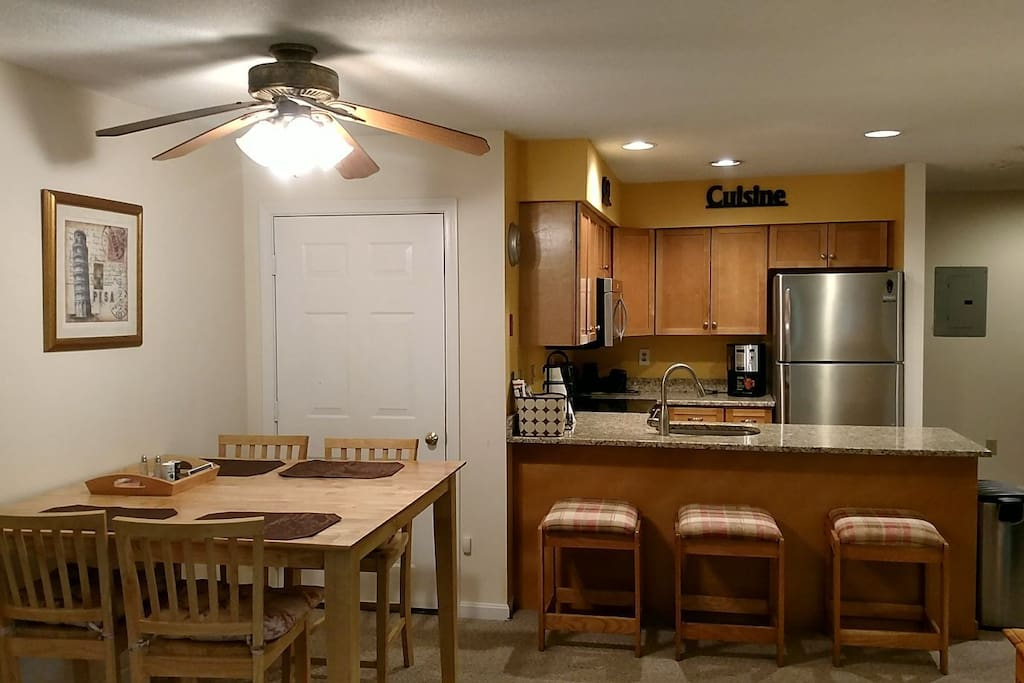 Dining are and large kitchen counter w additional seating