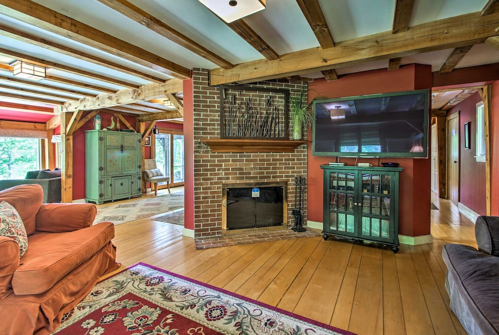 Marvel at the post and beam construction, vibrant colors, and beautiful rugs.