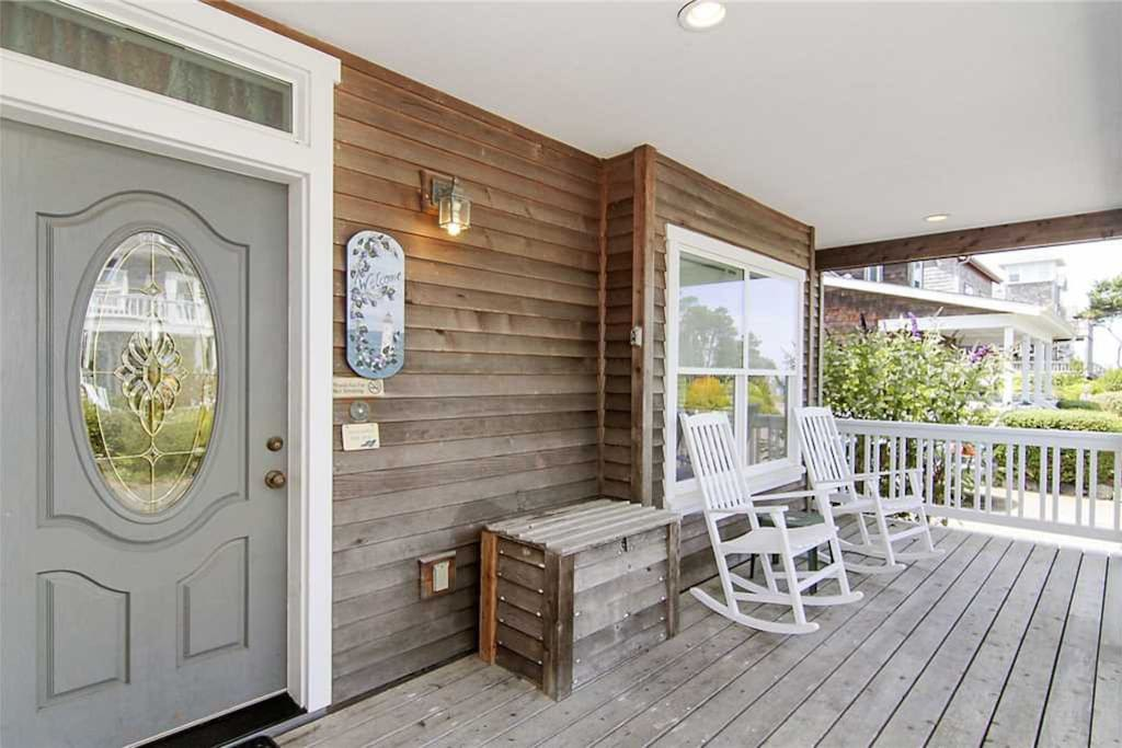 A welcoming front porch with seating to enjoy during your stay.