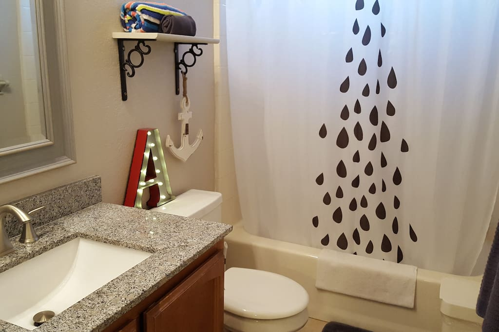 Full bathroom with shampoo & conditioner, body wash, towels, lotions