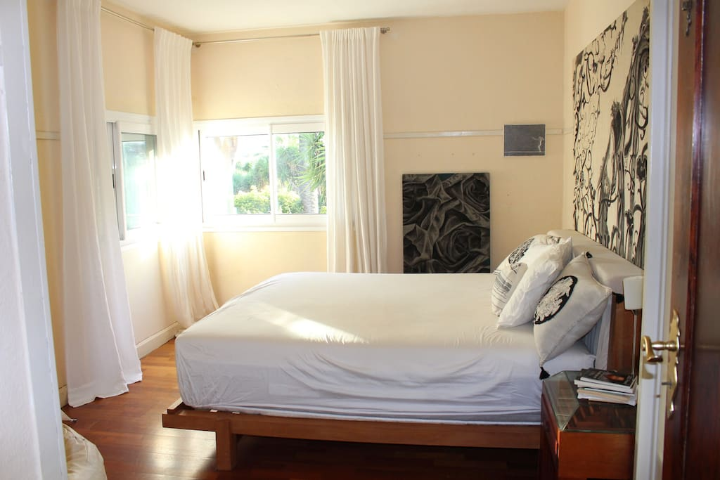 a bedroom with cotton mattress and ecological wooden bed