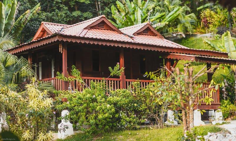 Wooden Villa @ Alamanda Villas Langkawi surrounded by garden and nature
