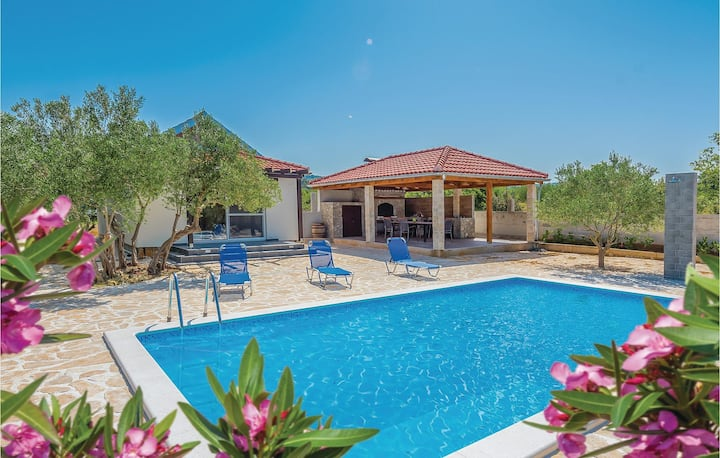 Nice home in Tisno with Outdoor swimming pool, WiFi and 2 Bedrooms
