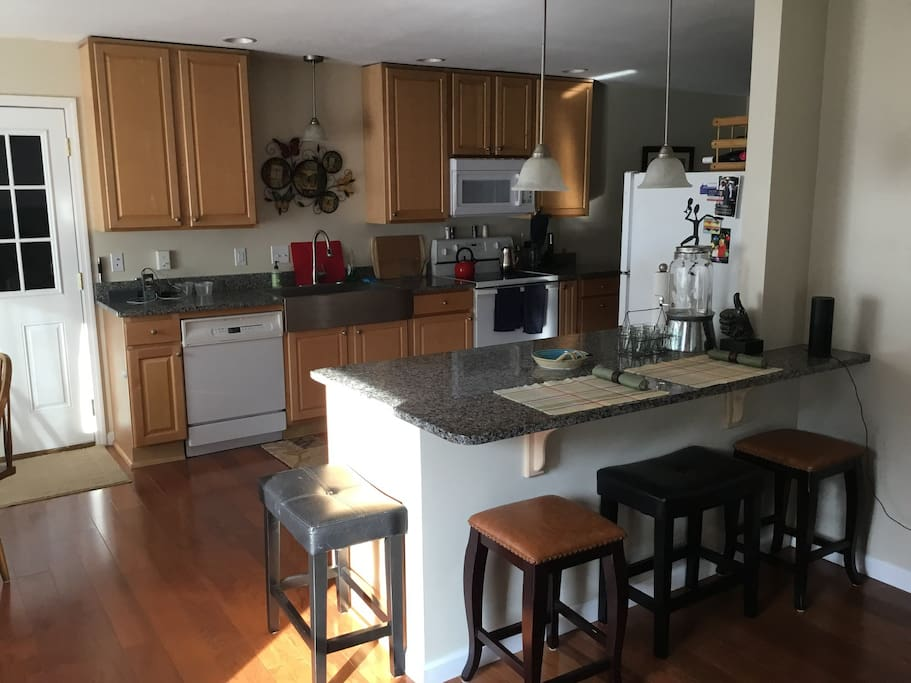 Granite Sit-At Counters open to Living Room from Kitchen