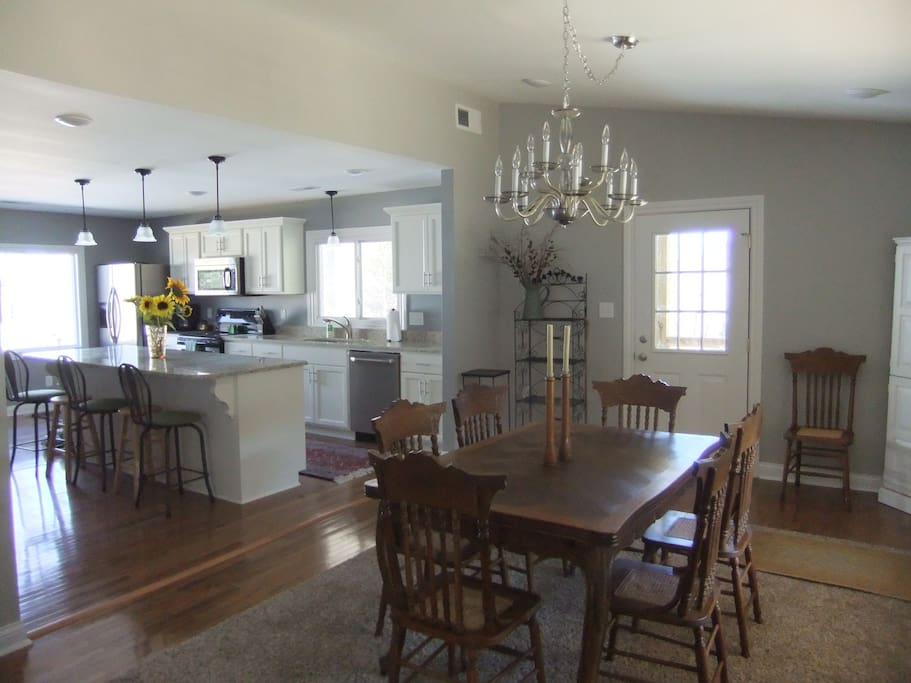 Open concept, dinning room with large windows and lots of natural light through out the house