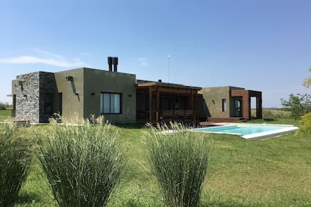 Olivia´s Ranch field with 4 bedrooms  and pool