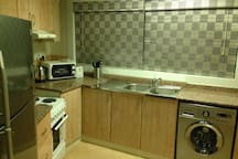 The kitchen has all what you need  refrigerator, washers  machine  with dryer, microwave. All equipment for cooking for the entire family